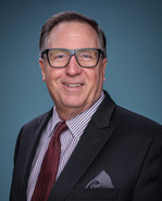 Dr. Roy L. Peterson, President and Chief Executive Officer